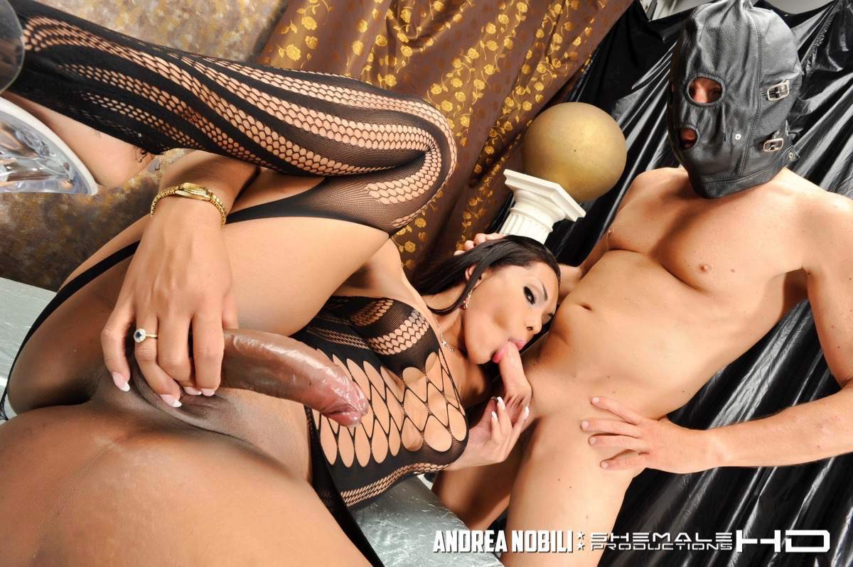 Awesome T-Girl With Huge Boobs Enjoying Slave Guys
