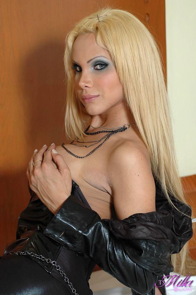 Blonde Busty Femboy In Black Leather