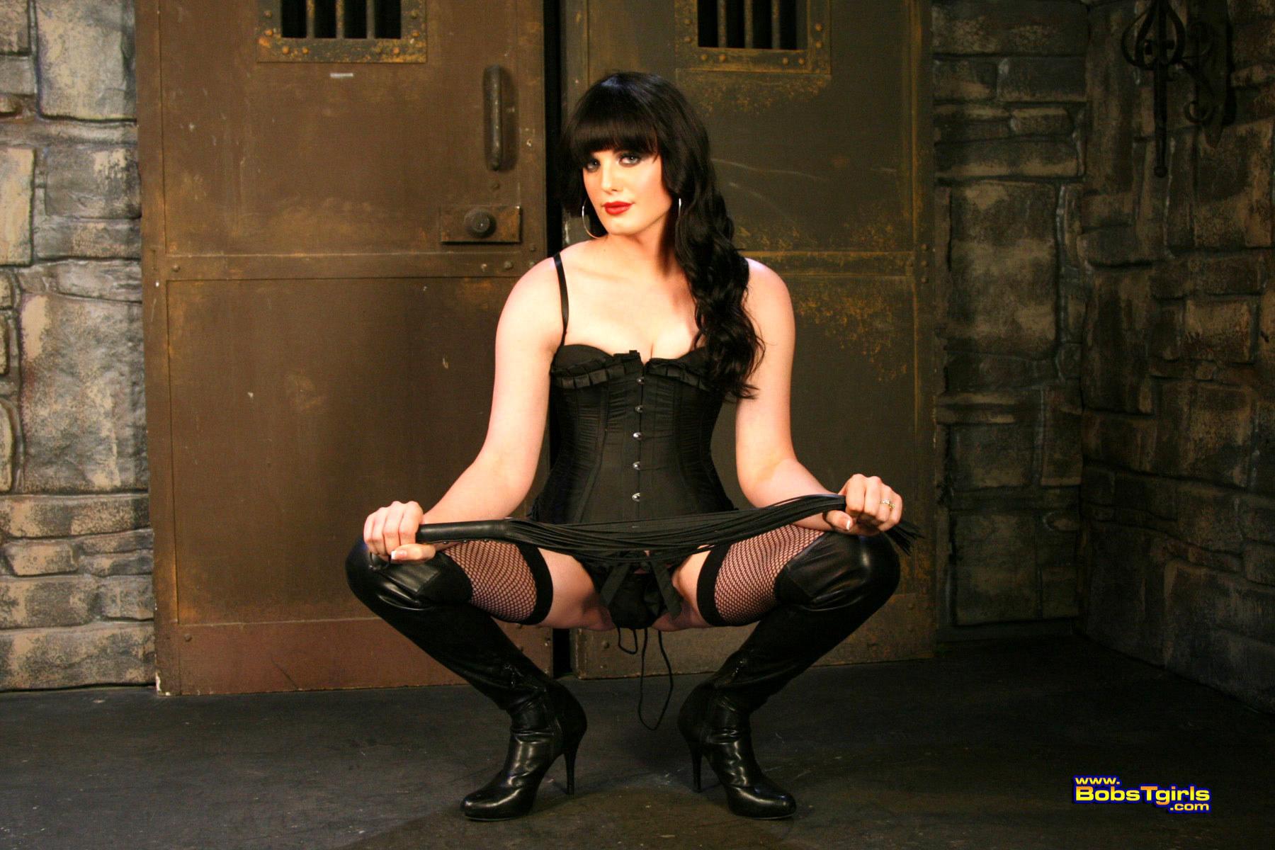Caged T-Girl Destiny Hart Posing Her Fantastic Body