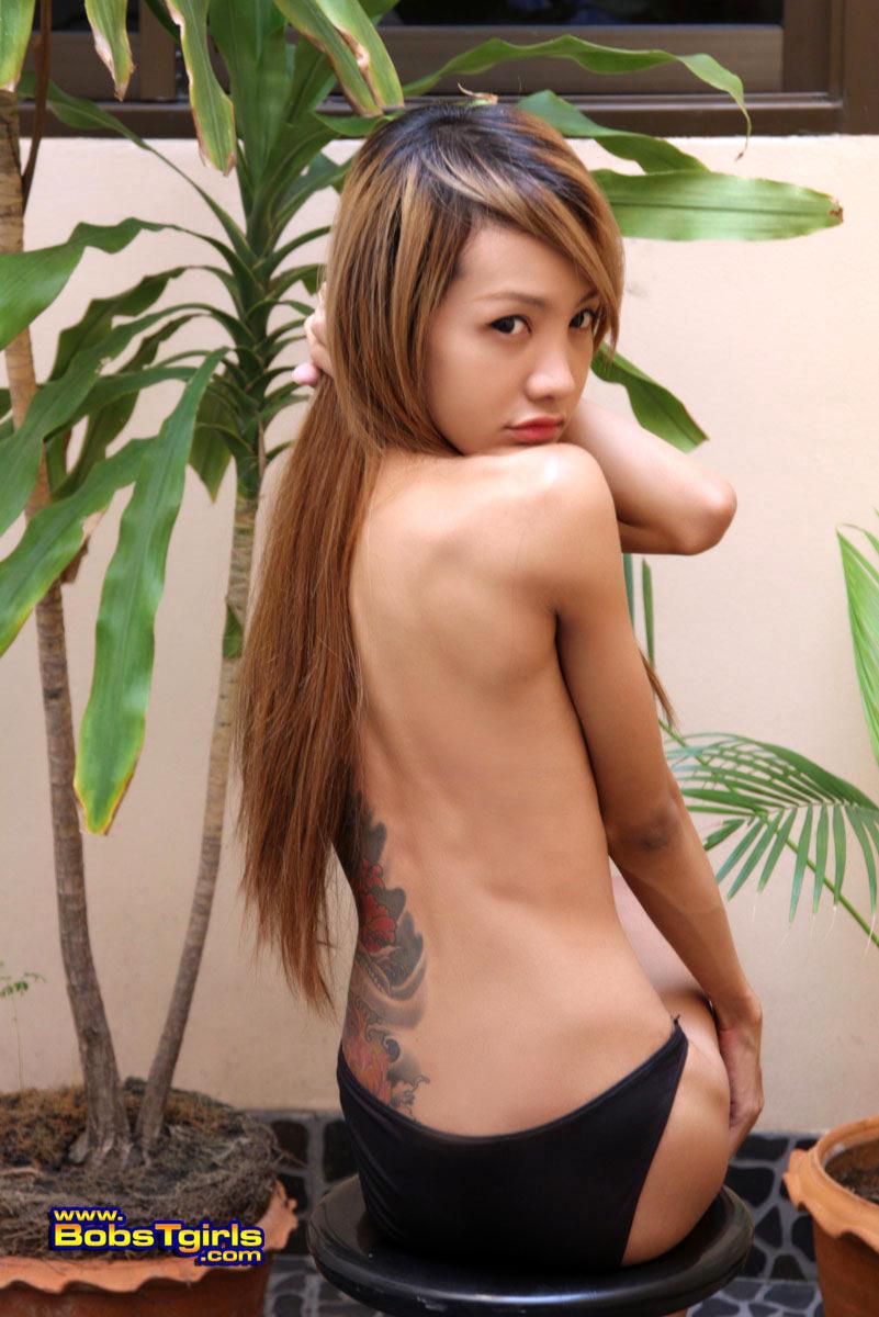 Exotic T-Girl Donut Strips Poses