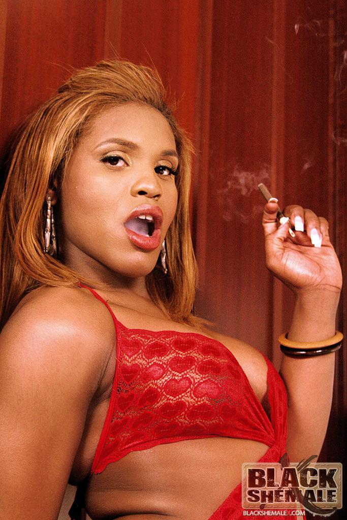 Gorgeous Black Ladyboy In Red Smoking