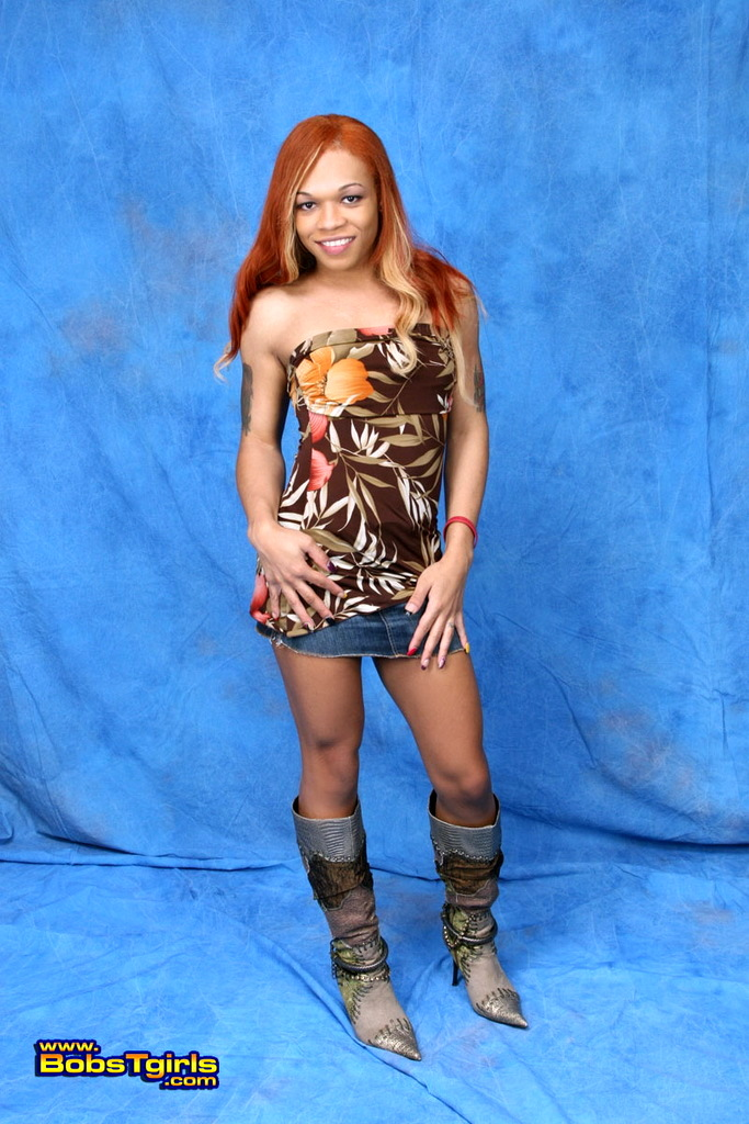 Innocent Transsexual Candi Love Posing In Spicy Boots