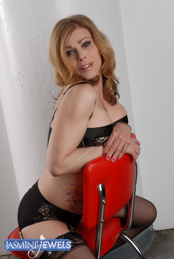 Inviting Transsexual MILF Posing In Suggestive Black Stockings