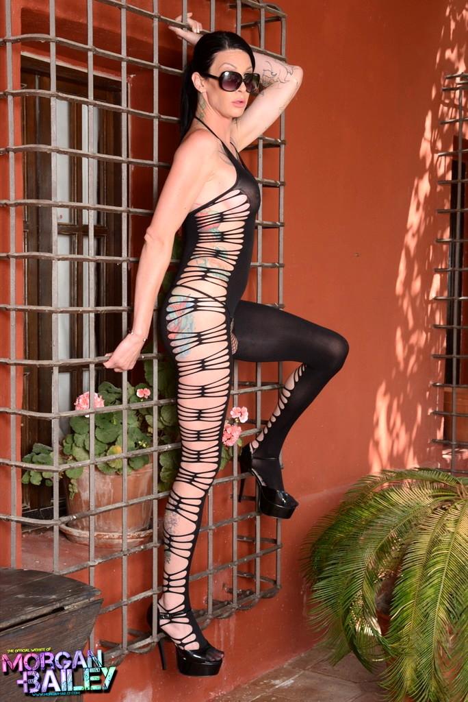 Sensuous Morgan Posing In Dirty Bodysuit
