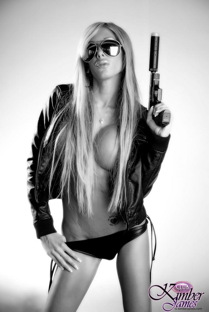 Super Flirtatious Kimber James Posing With A Gun In Black White
