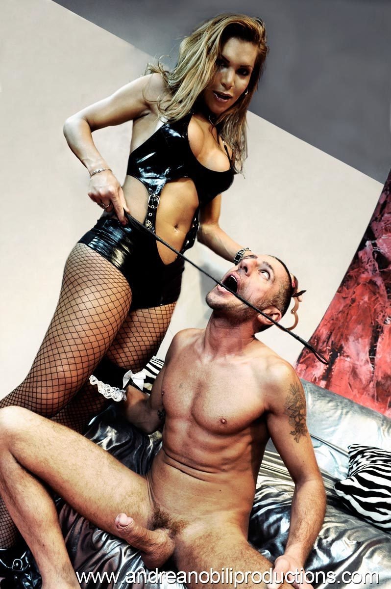 The Provocative Claudia In Fetish Outfit Using And Abusing Her Slave